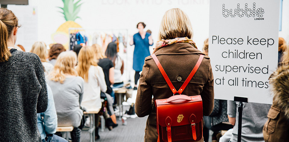 Bubble London, Childrenswear show, Adults listening to a speaker talking about childrenswear, childrenswear buyers, popular trade show, learn about kid's fashion, childrenswear industry, kids fashion industry, kids fashion buyer, kids fashion seller, kid's clothes shops,